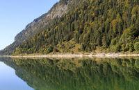 Autumnal reflection, Sylvenstein Reservoir, Bavaria, Germany