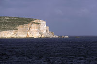 View from the Marfa peninsula on steep coast in the southeast of Comino
