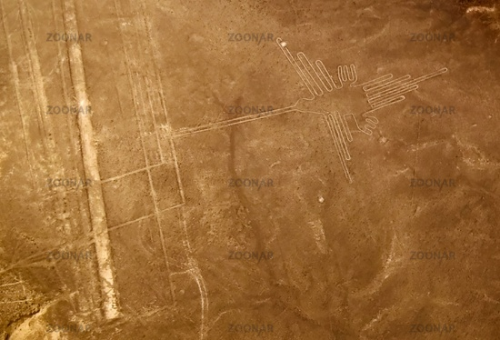 Aerial airplane panoramic view to Nazca geoglyph lines aka Hummingbird, Ica, Peru
