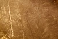 Aerial airplane panoramic view to Nazca geoglyph lines aka Hummingbird, Ica, Peru