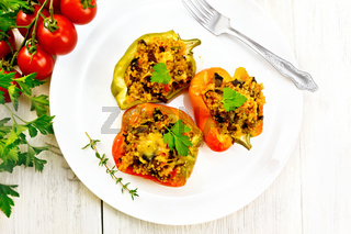 Pepper with mushrooms and couscous in plate on light board