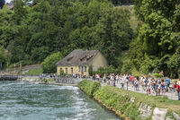 Tourists on the promenade in front of the Rhine Falls in Neuhaus