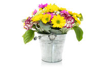 Bouquet from various flowers in a metal bucket