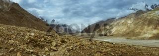 Panorama of beautiful valley in Karakoram Mountain Range with majestic peaks of Trango Towers above Baltoro Glacier.