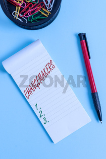 Writing note showing Changemakers. Business photo showcasing Young Turk Influencers Acitivists Urbanization Fashion Gen X Notebook and stationary with mouse above pastel backdrop.