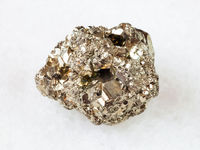 rough iron pyrite stone on white