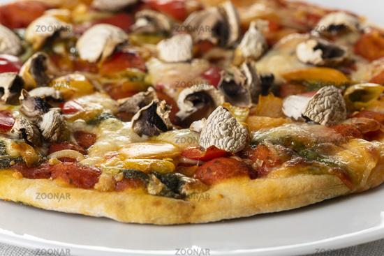 Mushroom pizza on a white plate