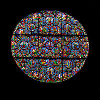 detail of a stained glass window of the Notre Dame de Dijon church in Dijon