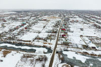 Winter view from the bird's eye view of the village. The streets are covered with snow