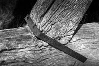 Black and white detail of historic wooden beam structure