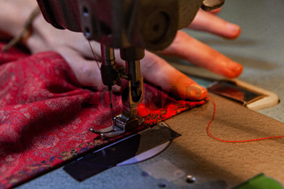 Red cloth on industrial sewing machine