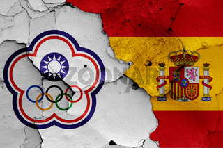 flags of Chinese Taipei and Spain painted on cracked wall