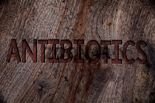 Writing note showing  Antibiotics. Business photo showcasing Antibacterial Drug Disinfectant Aseptic Sterilizing Sanitary Wooden background vintage wood board wild rough old antique messages.