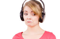 Woman sad girl in big headphones listening music
