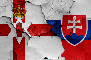 flags of Northern Ireland and Slovakia painted on cracked wall