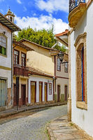Facade of old houses built in colonial architecture at Ouro Preto