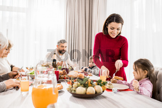 Mother Serving Food at Christmas table