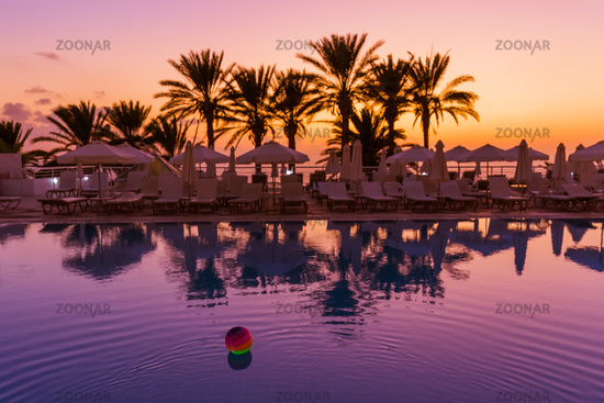 Swimming pool on Cyprus island at sunset