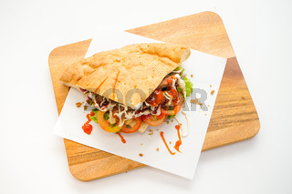 Doner Kebab top view on chopping board on white background
