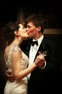 Newlyweds kiss dancing