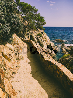 a hiking trail along the cliffs for tourists on Costa Brava of the Mediterranean Sea in Spain near Lloret de Mar