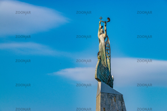 Statue of St. Nicholas in Nessebar ancient city, one of the major seaside resorts on the Bulgarian Black Sea Coast. Nesebar or Nesebr is a UNESCO World Heritage Site. Sunny day with blue sky