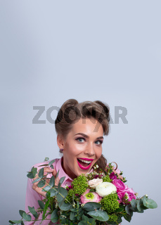 Woman surprised with flowers