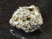 rough iron pyrite stone on black