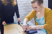 Professional women decorators working with kraft paper