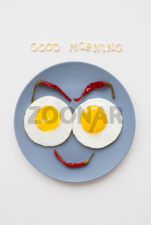 two beautiful eggs on a plate
