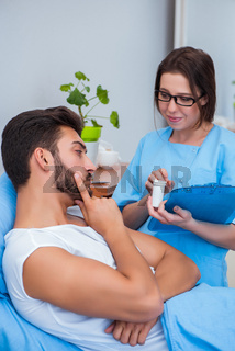 Woman doctor examining male patient in hospital