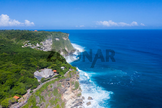 beautiful uluwatu cliff with blue sea in bali island