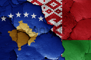 flags of Kosovo and Belarus painted on cracked wall