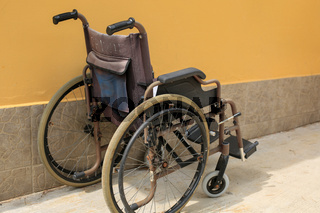 Empty wheelchair parked outside
