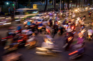 Dense traffic at night intersection at Saigon, Vietnam.