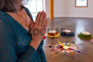 Old woman prays in meditation room