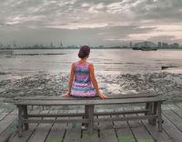 Tourist sitting at Yeoh jetty, Georgetown, Penang, Malaysia