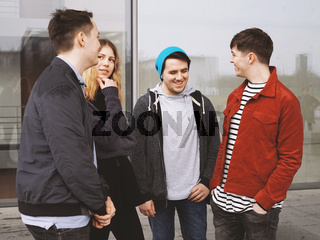 group of teenage friends talking laughing and having fun together
