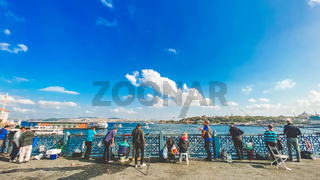 October 27, 2019 Istanbul. Turkey. Fisherman fishing on the Galata Bridge in Istanbul Turkey. People walk on Galata bridge. Vacation in Istanbul. Galata Bridge favorite traditional place for fishing