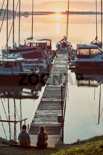 Yachts and boats moored in a harbour