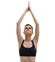 Image of yoga trainer posing in lotus position