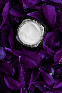 Luxury face cream moisturizer for facial skin on purple flower background, floral essense, spa cosmetics and beauty emulsion for skincare brand product