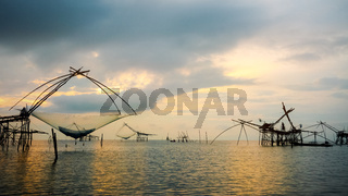 Fisherman are fishing at Pakpra canal during sunrise rural lifestyle in Thailand