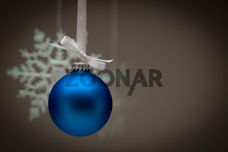 Snowflake and Blue Christmas Ornament Against Dark Background
