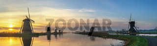 Rotterdam Netherlands, sunrise panorama landscape of Dutch Windmill at Kinderdijk Village