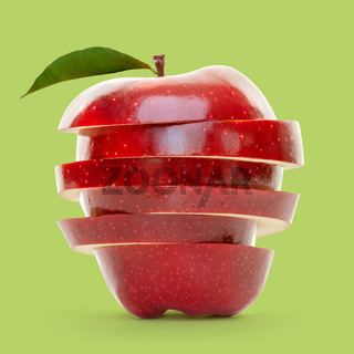 Red apple slices piled up and isolated on green background