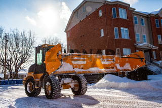 Snowplow tractor clearing snow