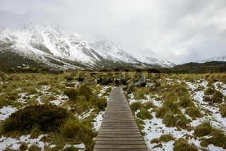 Curvy hanging pathway protects mountain ecosystem at Hooker Valley Track