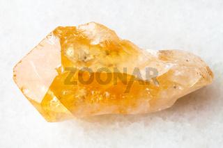 raw crystal of Citrine gemstone on white
