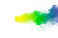 Colorful powder explosion on white background.Abstract blue yellow green  color dust particles splas